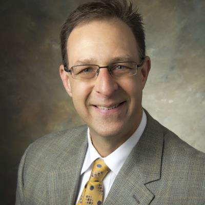 Dr David M Warwick, D.C.